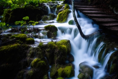 time-lapse photography of water stream long exposure teams background