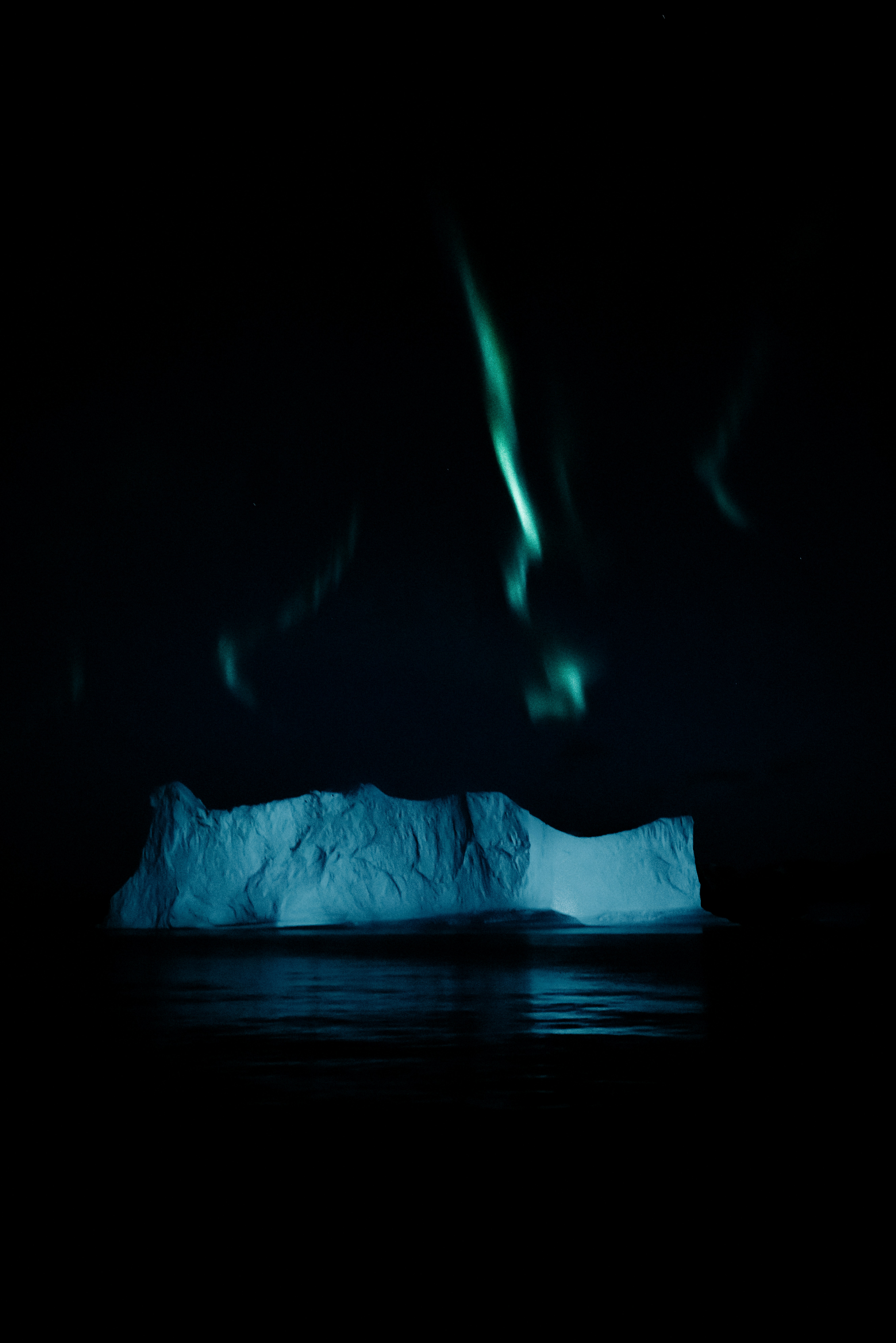 ice berg and aurora borealis