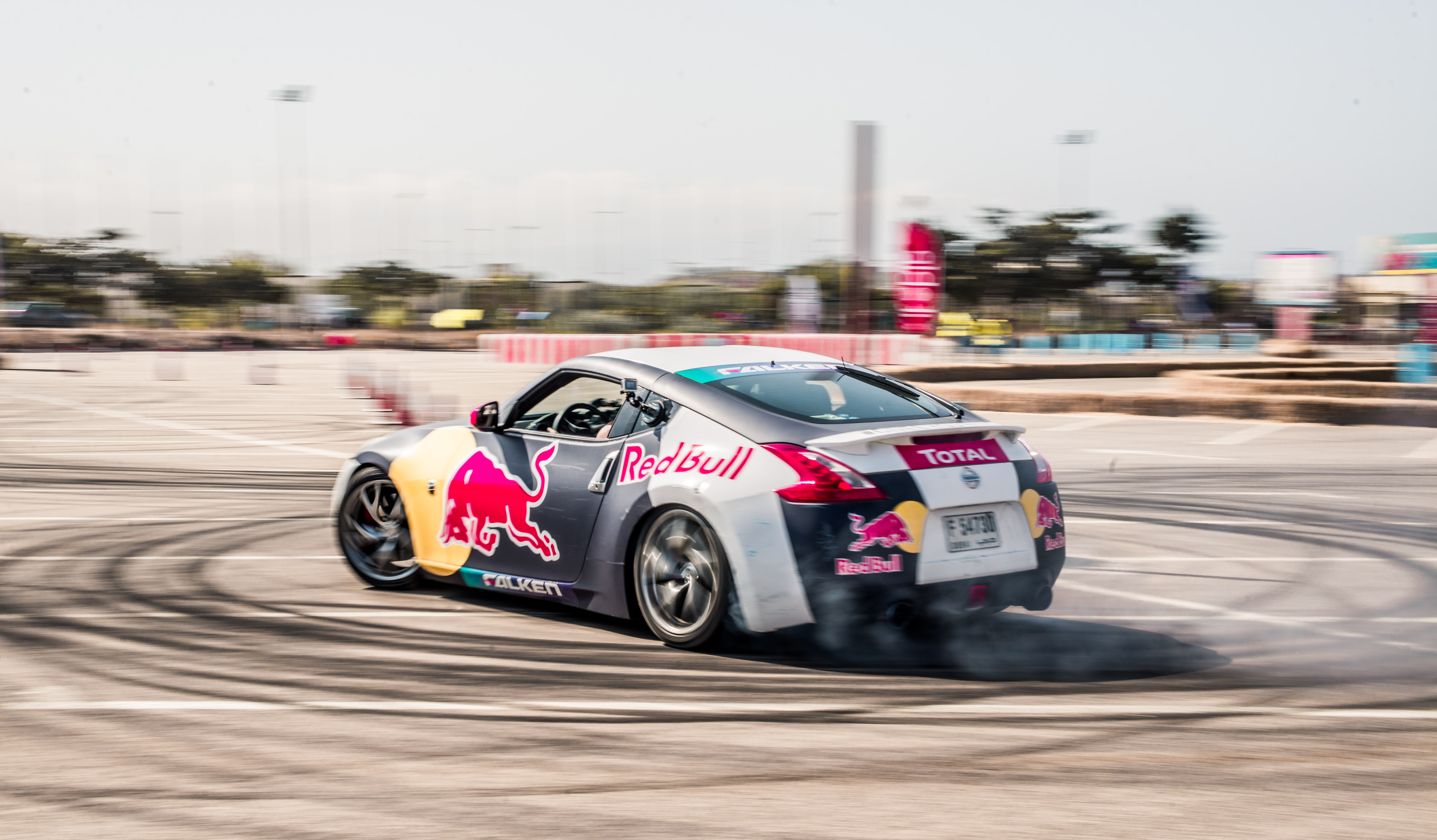 black and gray rally car performing drift