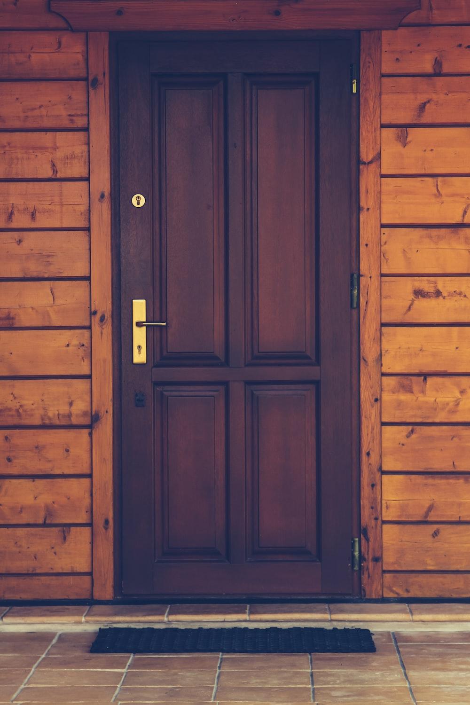 black wooden 4-panel door closed