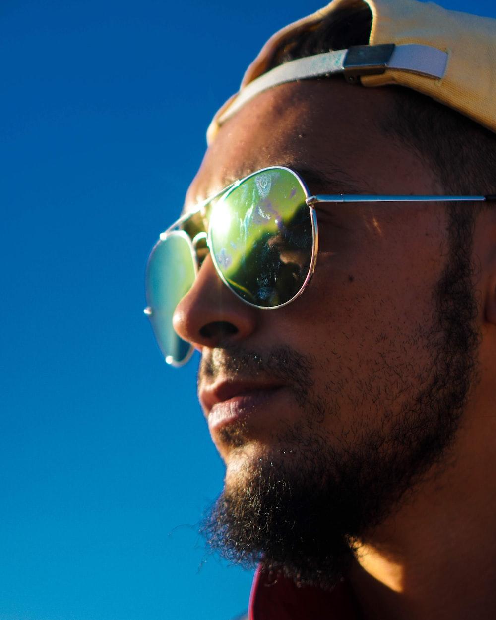 man wearing sunglasses facing sideways