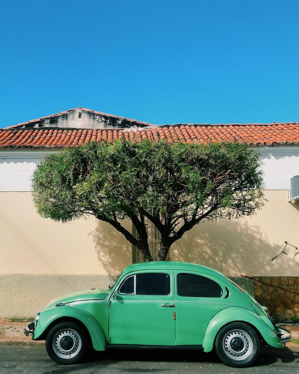 teal Volkswagen beetle car
