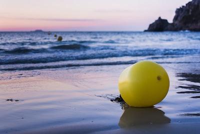 yellow tank in seashore