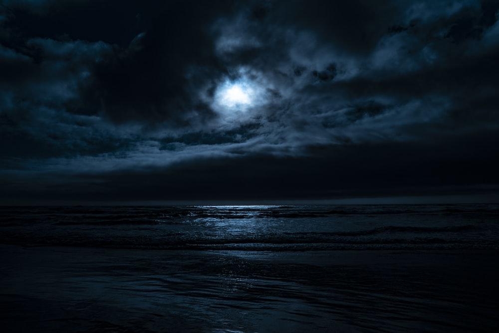 body of water under full moon
