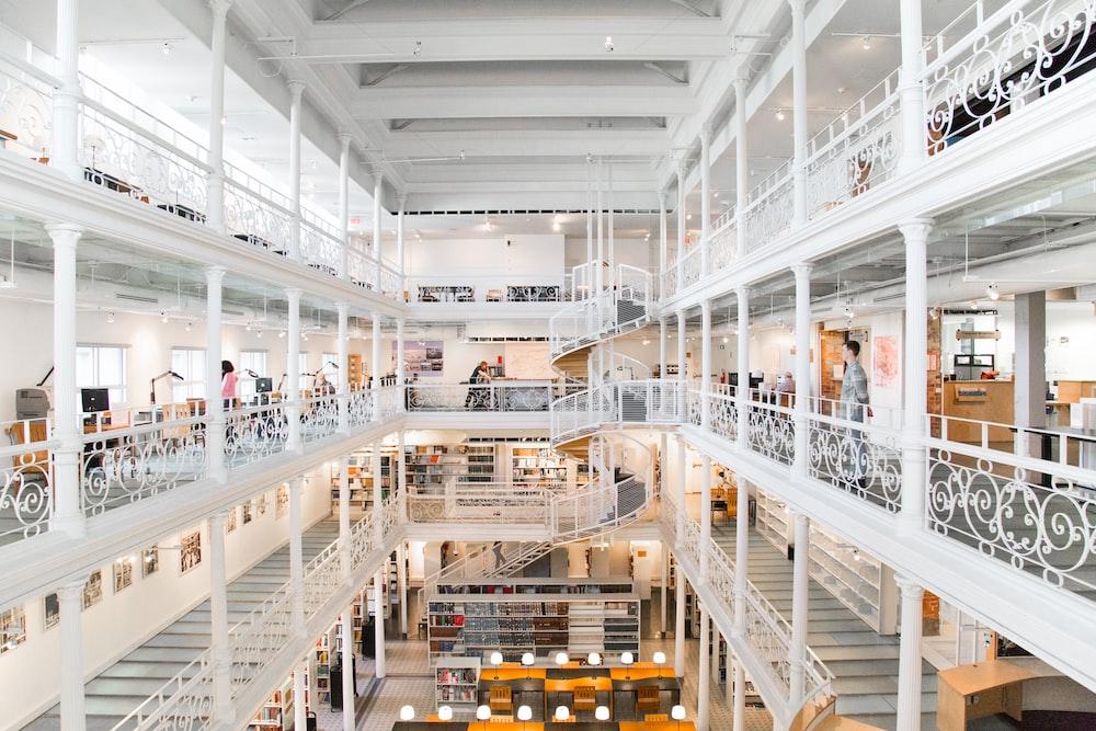 people inside white concrete building