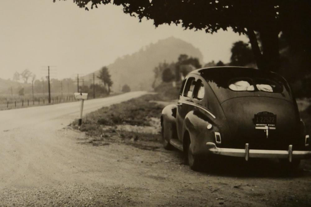 sepia photo of vehicle on roadside