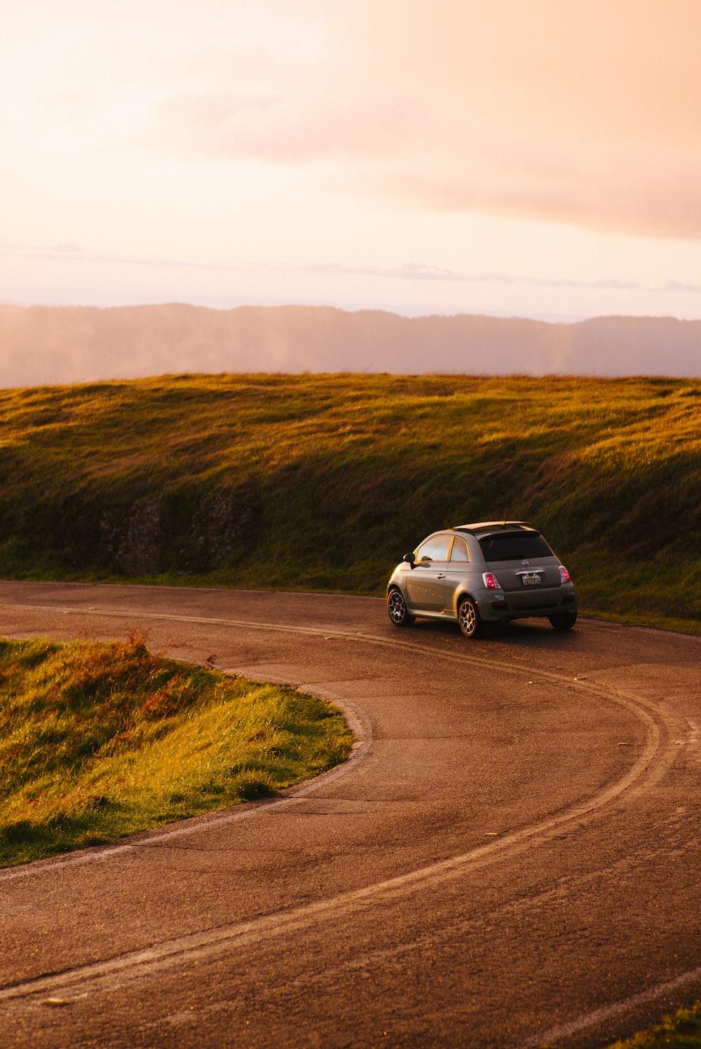 gray 3-door hatchback on road