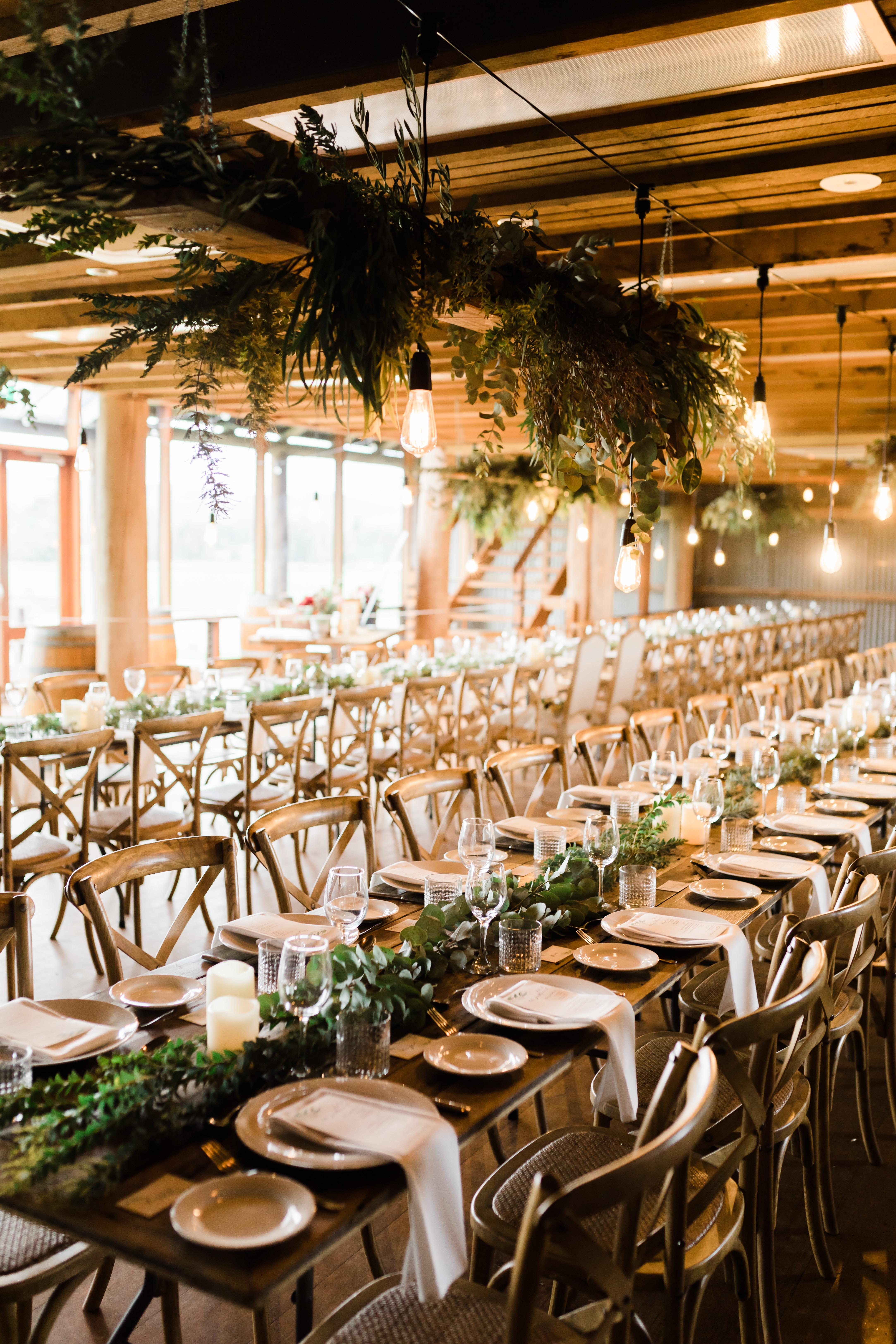 white dinnerware set on brown wooden dining sets inside room