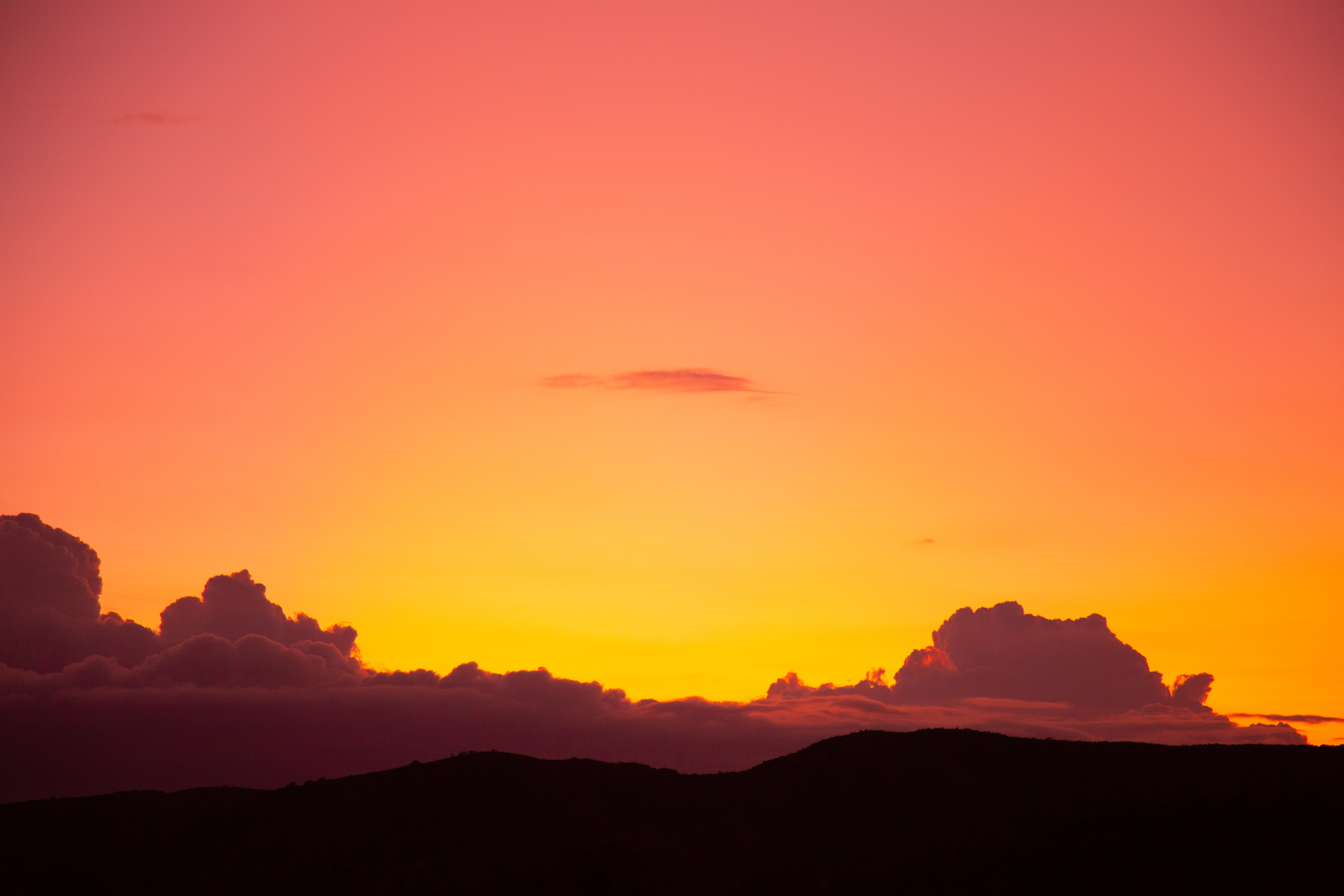 photo of sunset over the clouds