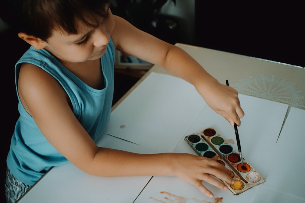 boy using watercolor