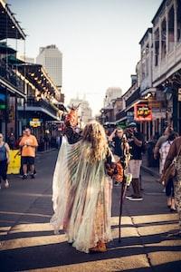 person raising mask on street