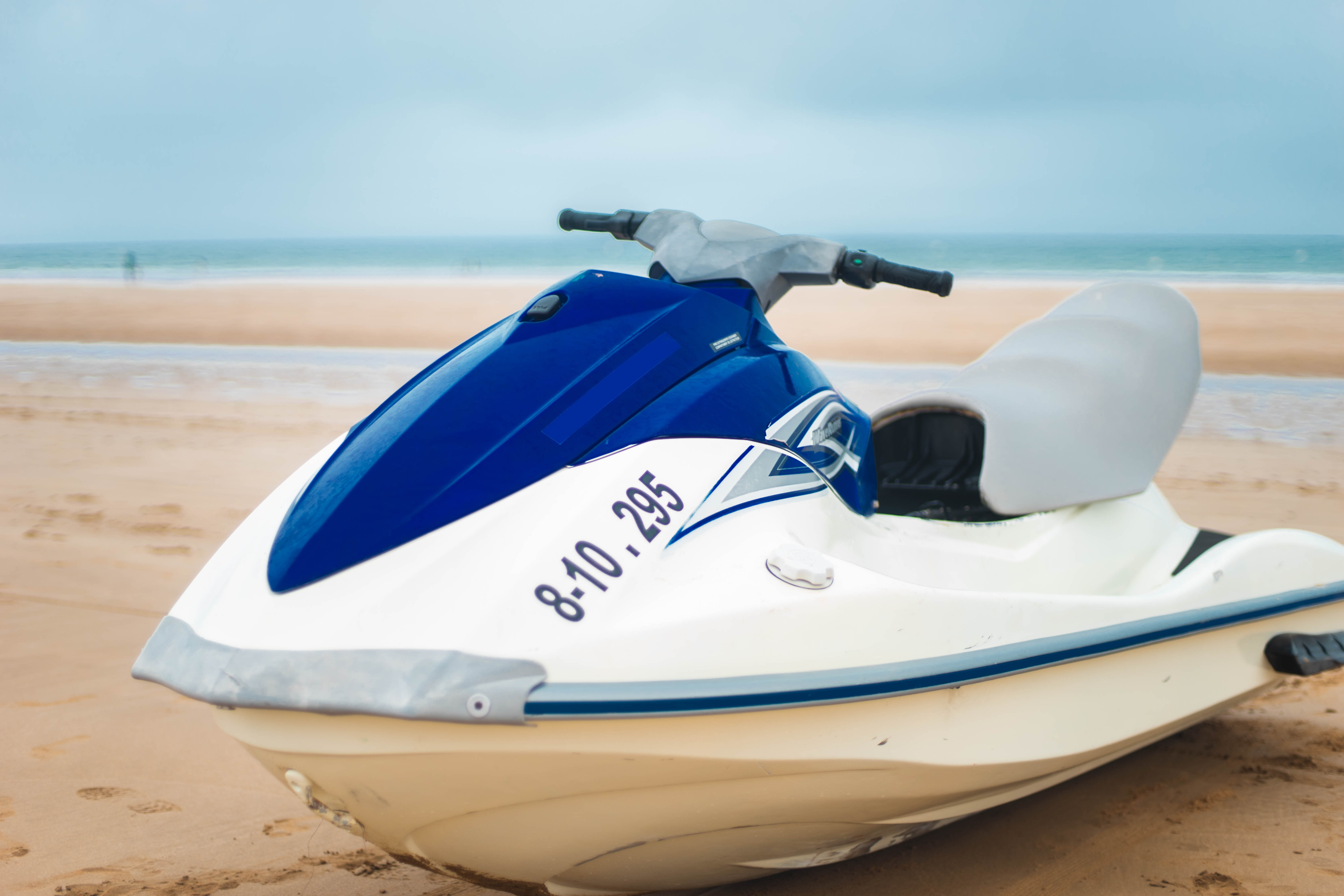 white and blue personal watercraft