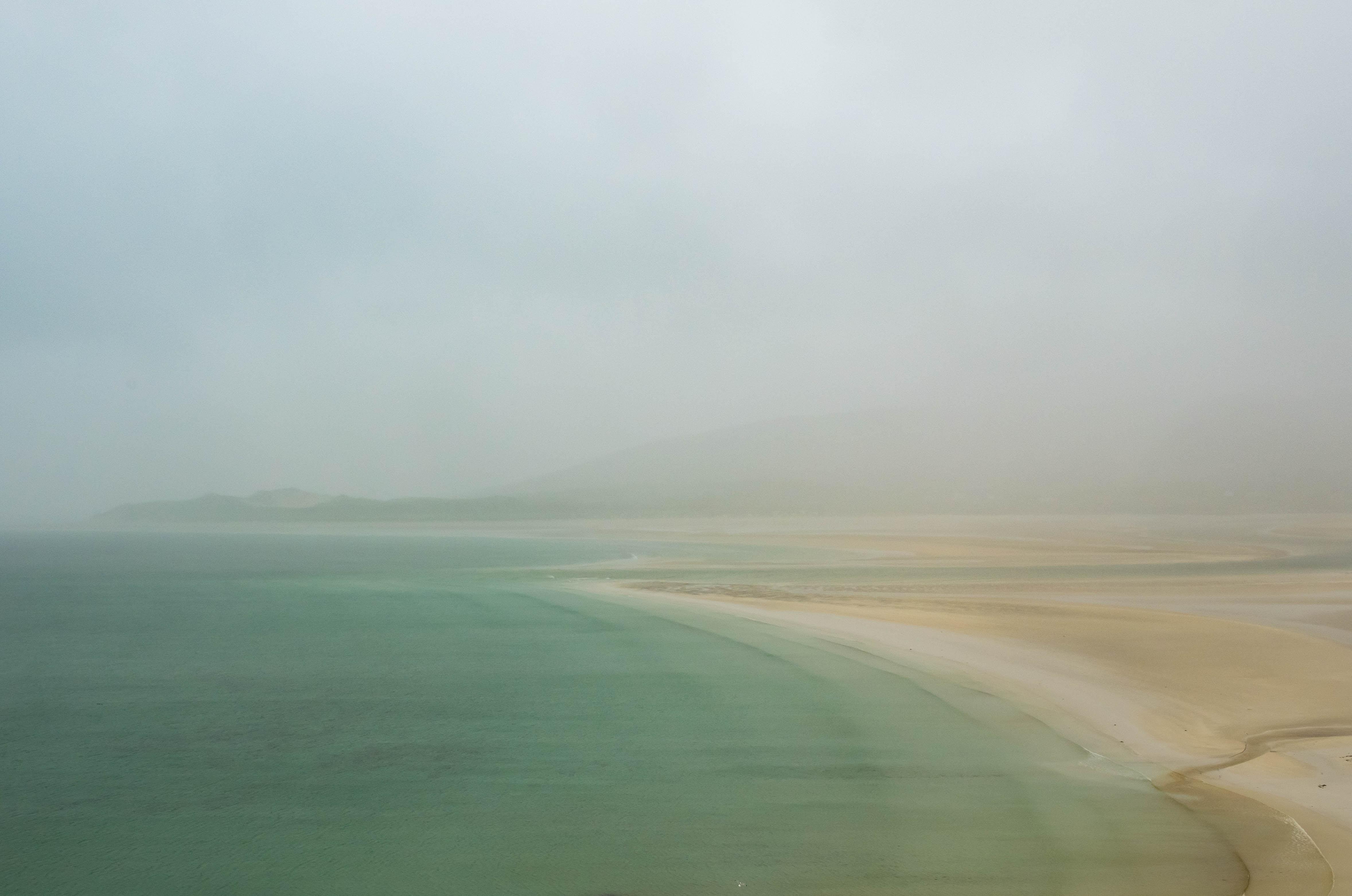 ocean waters beside coastline