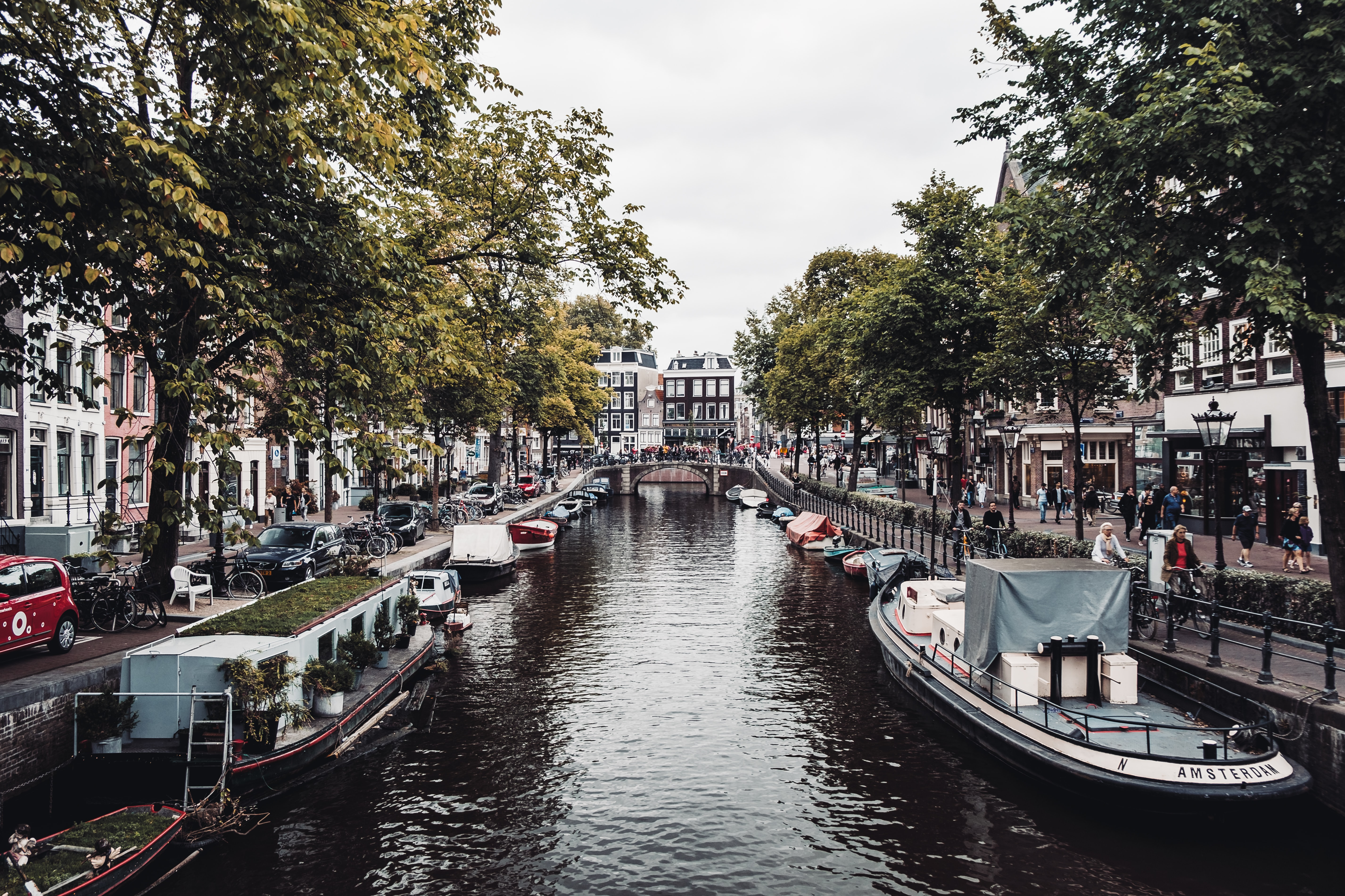 boats on canal during daytime