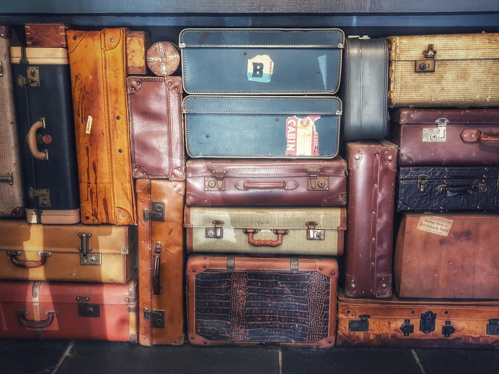 low light photography of stacked luggage