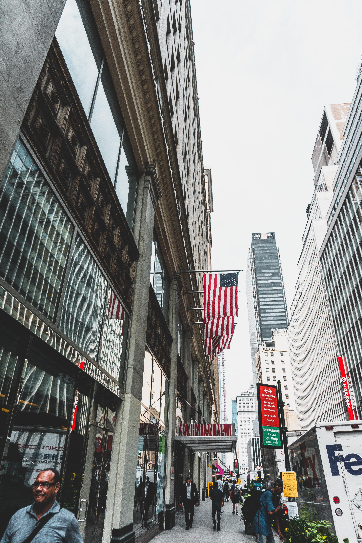people walking near high-rise building