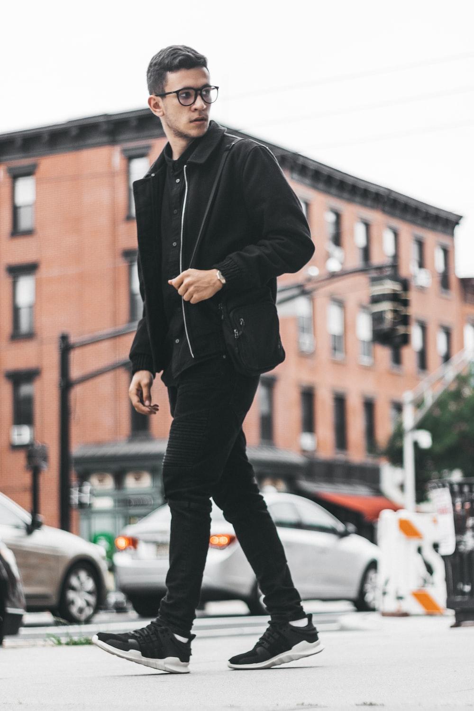 man walking beside the road