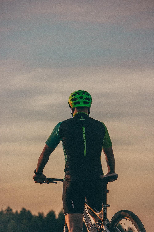 man riding bicycle during day time
