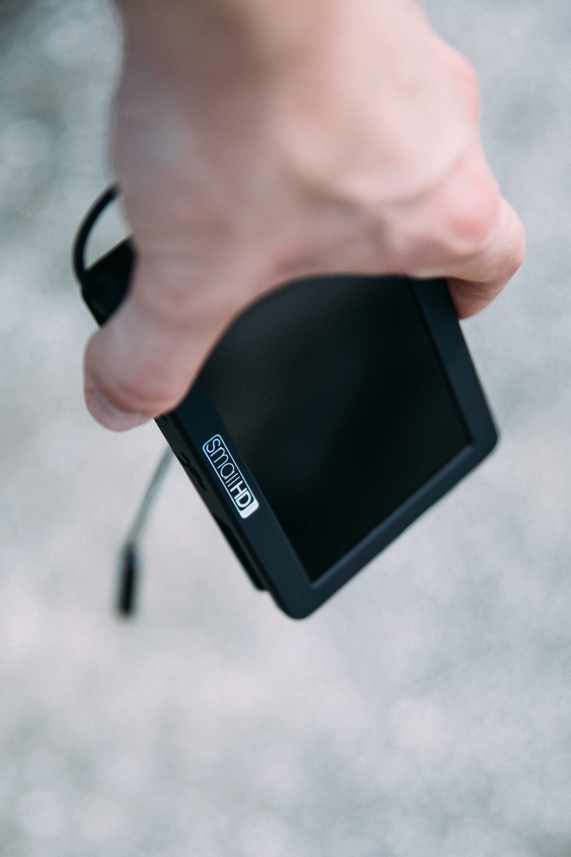 person holding black Small HD GPS navigator