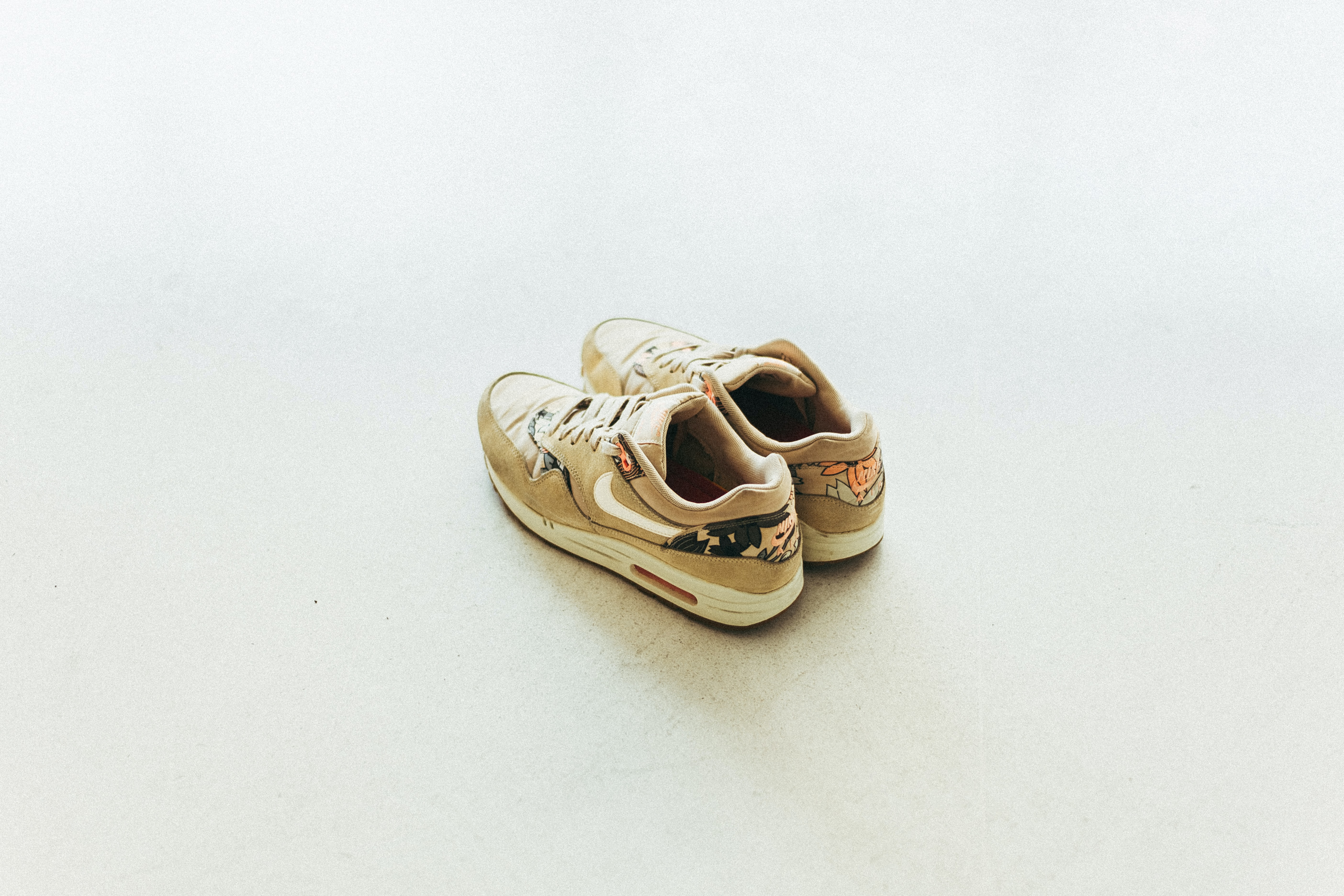 brown-and-white Nike low-top sneakers
