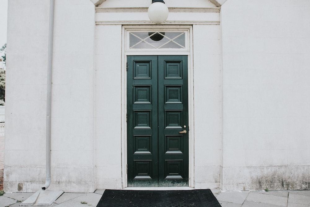 black door rug placed near black entrance door