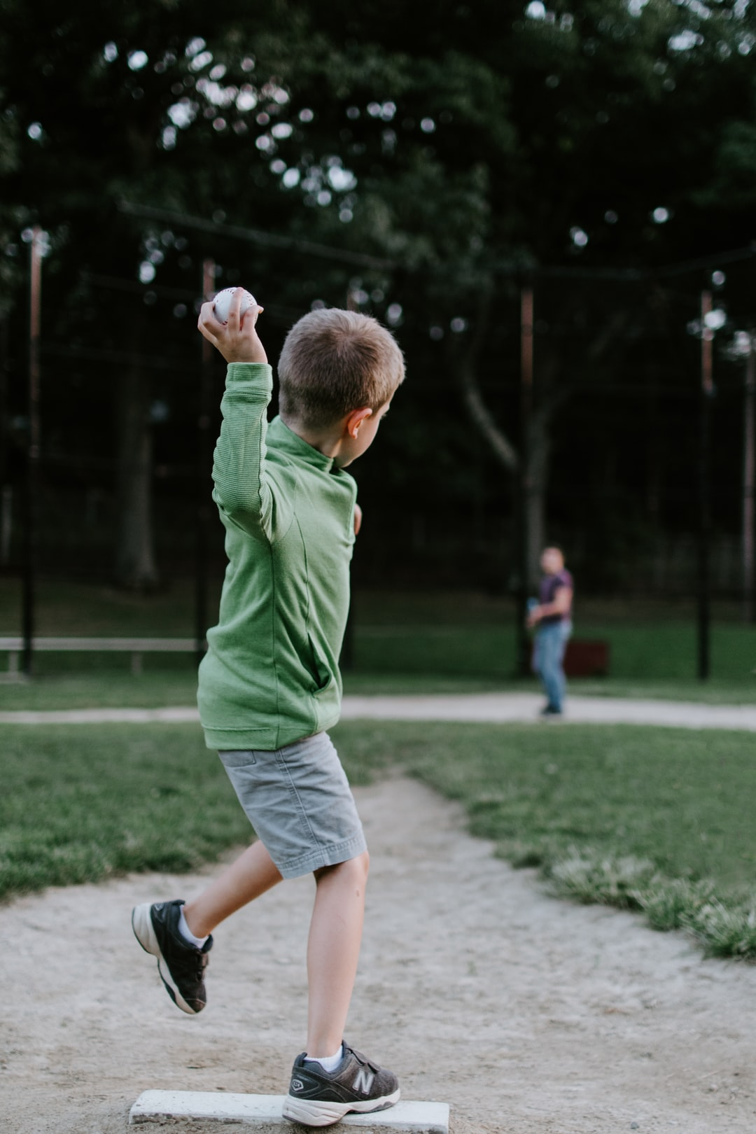 Son and Dad playing baseball in the park