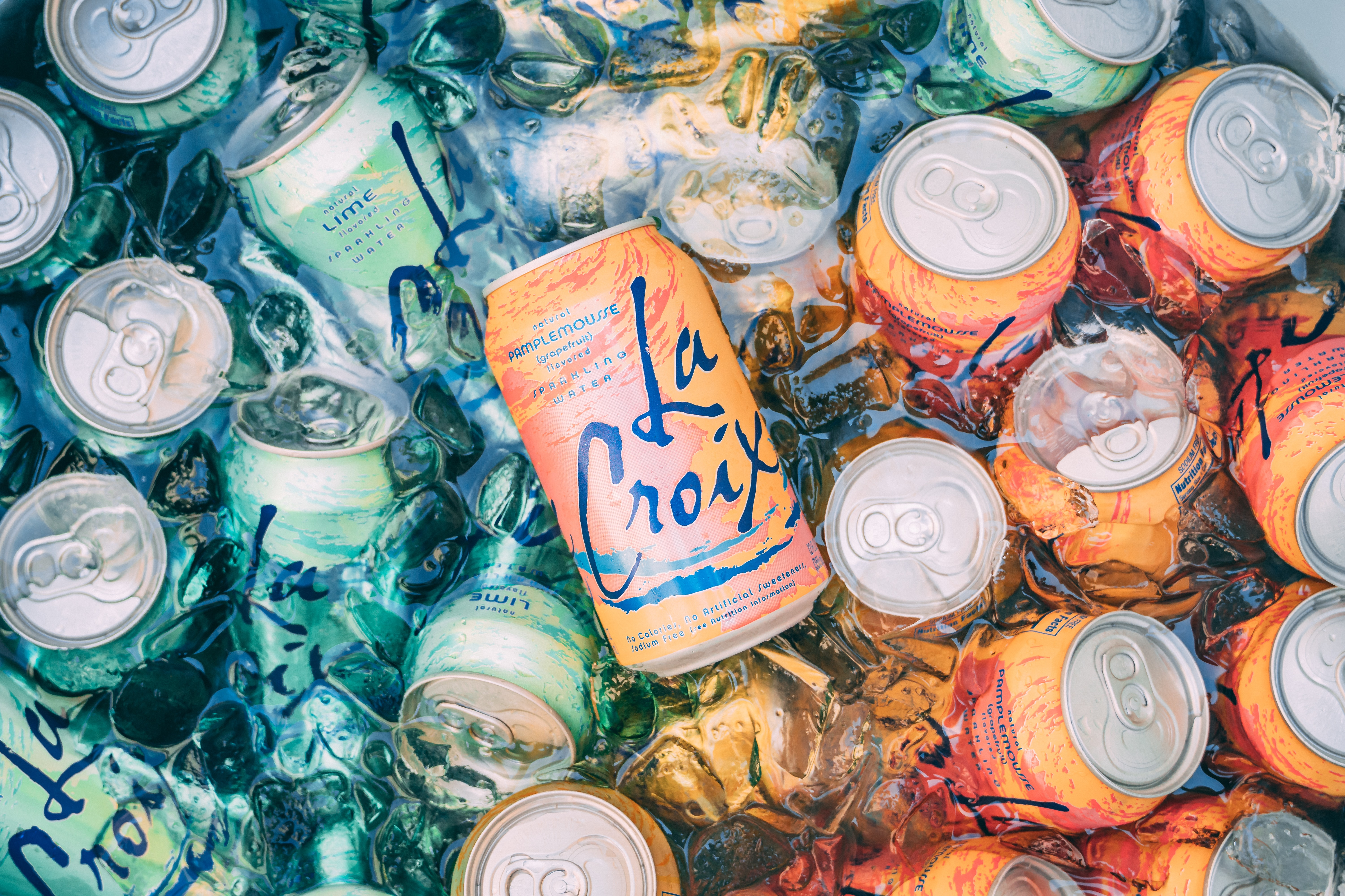 top view photography of orange steel soda can lot