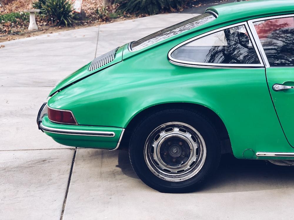 closed green car trunk lid