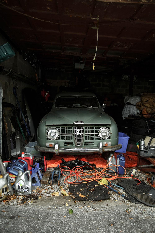green vehicle inside garage