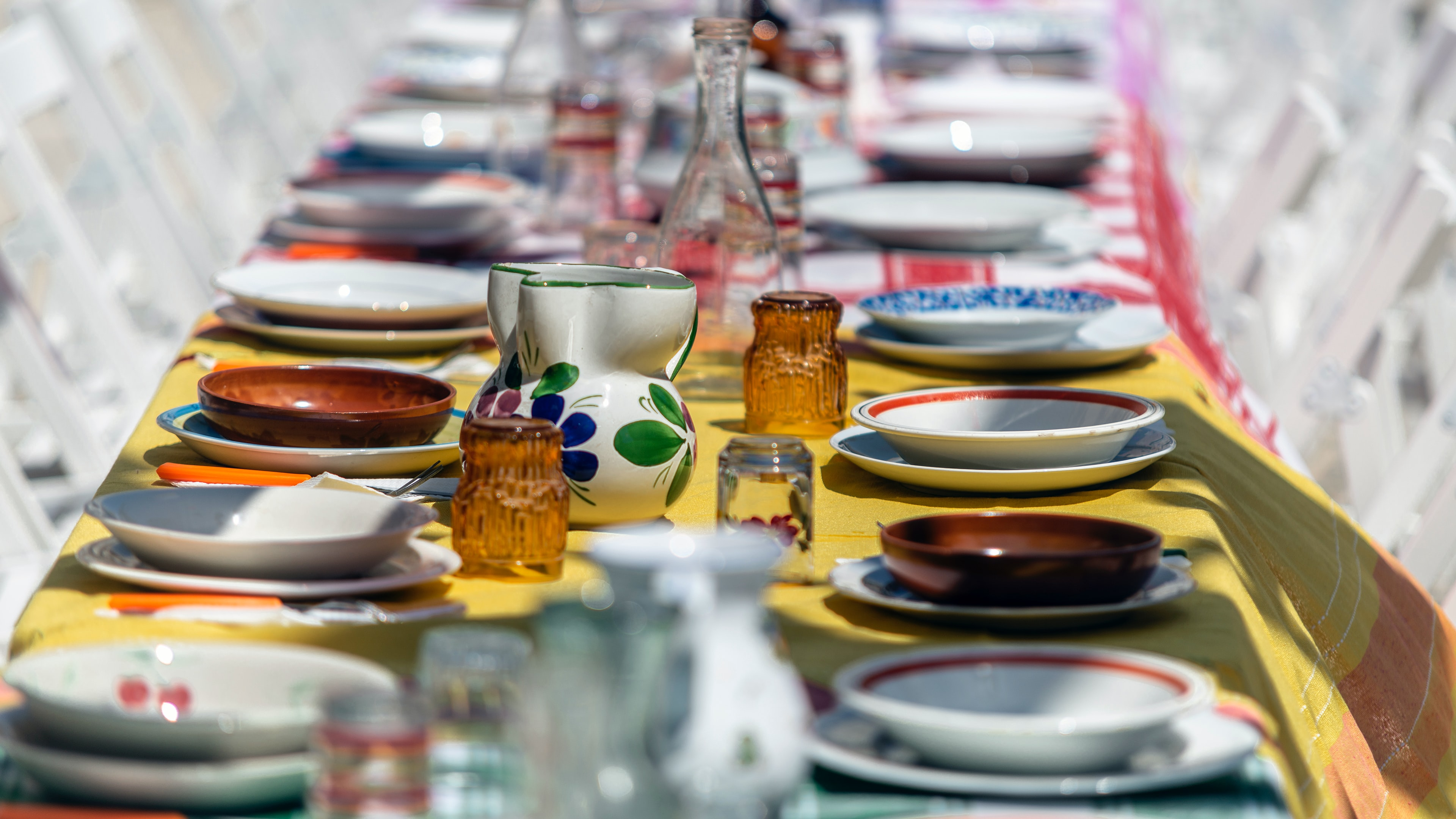 selective focus photography of dinnerware on table