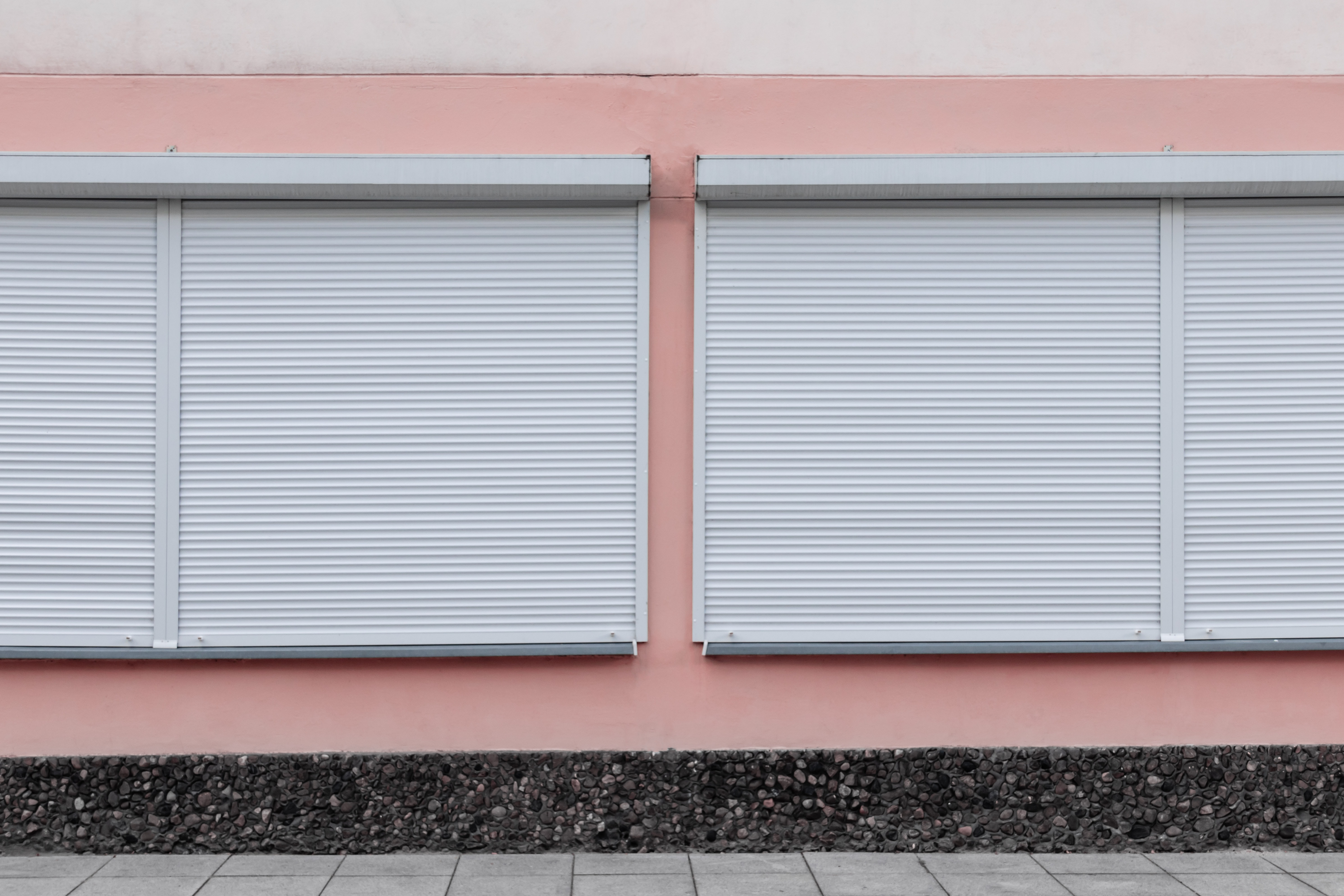 white window blinds closed