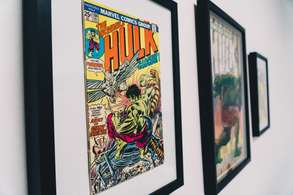 black wooden framed The Incredible Hulk comic book
