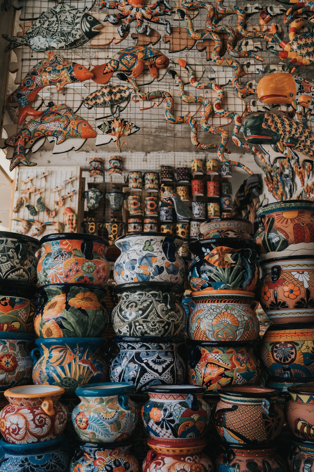 assorted-color clay pots arranged together