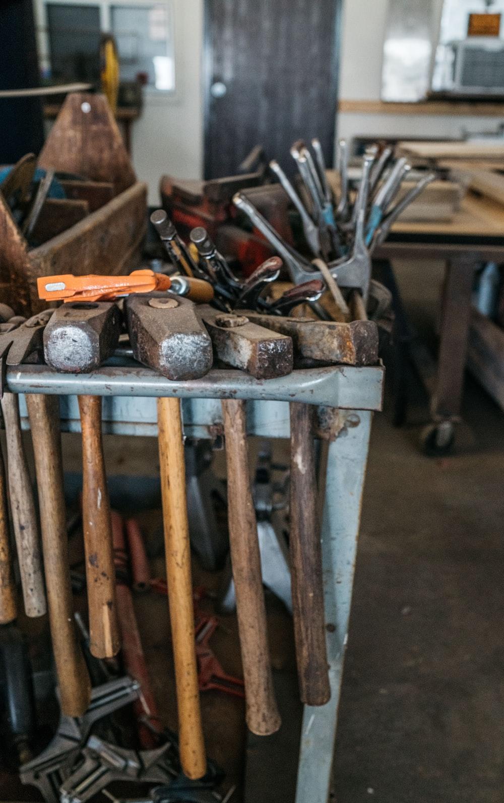 several handheld tools on metal rack