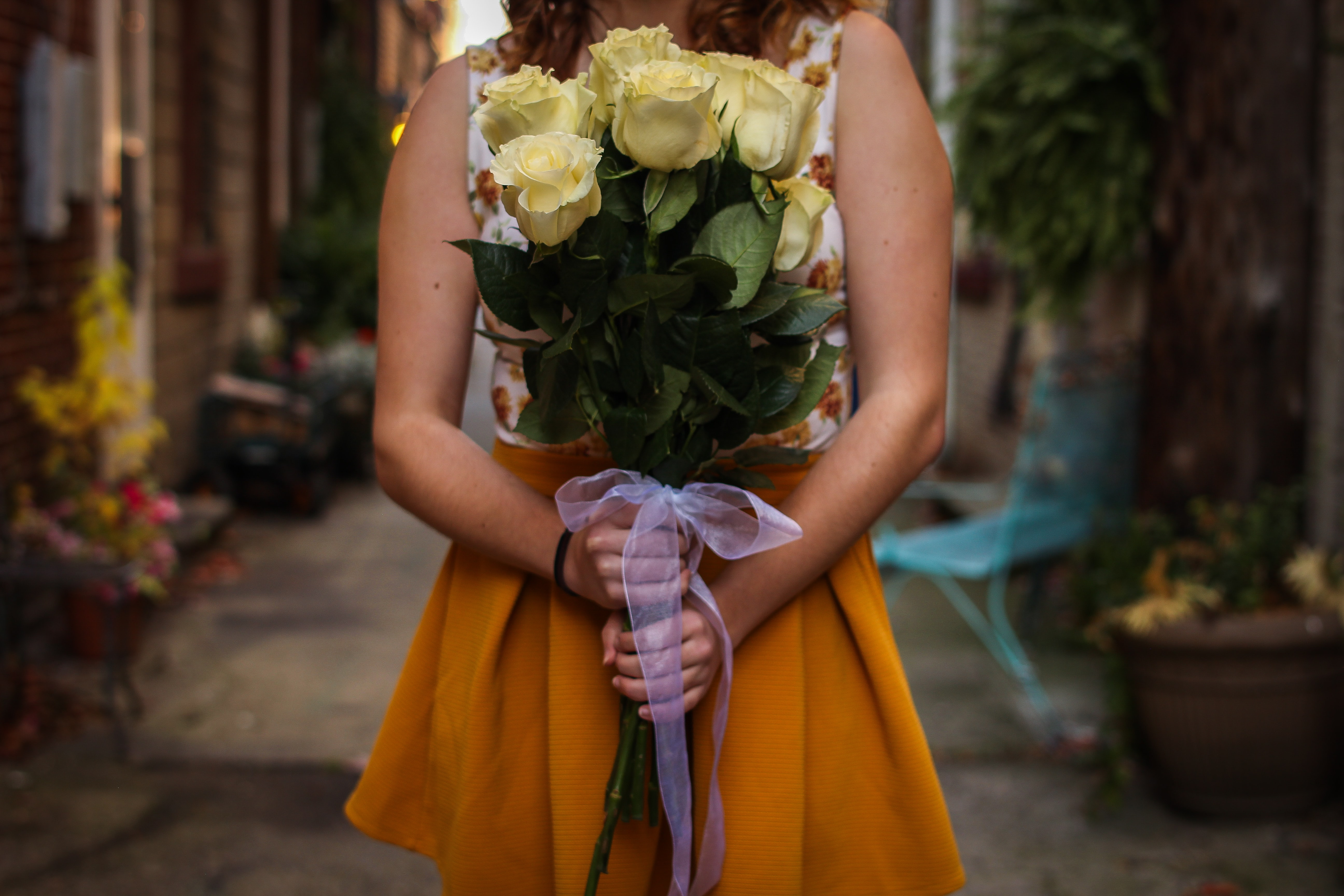 woman holding boquet of flowers