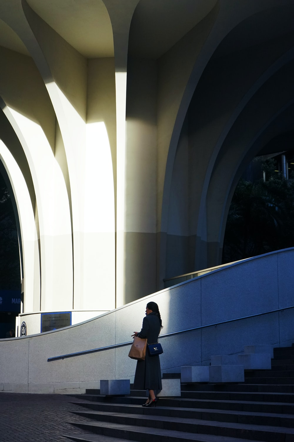 woman standing outside the building