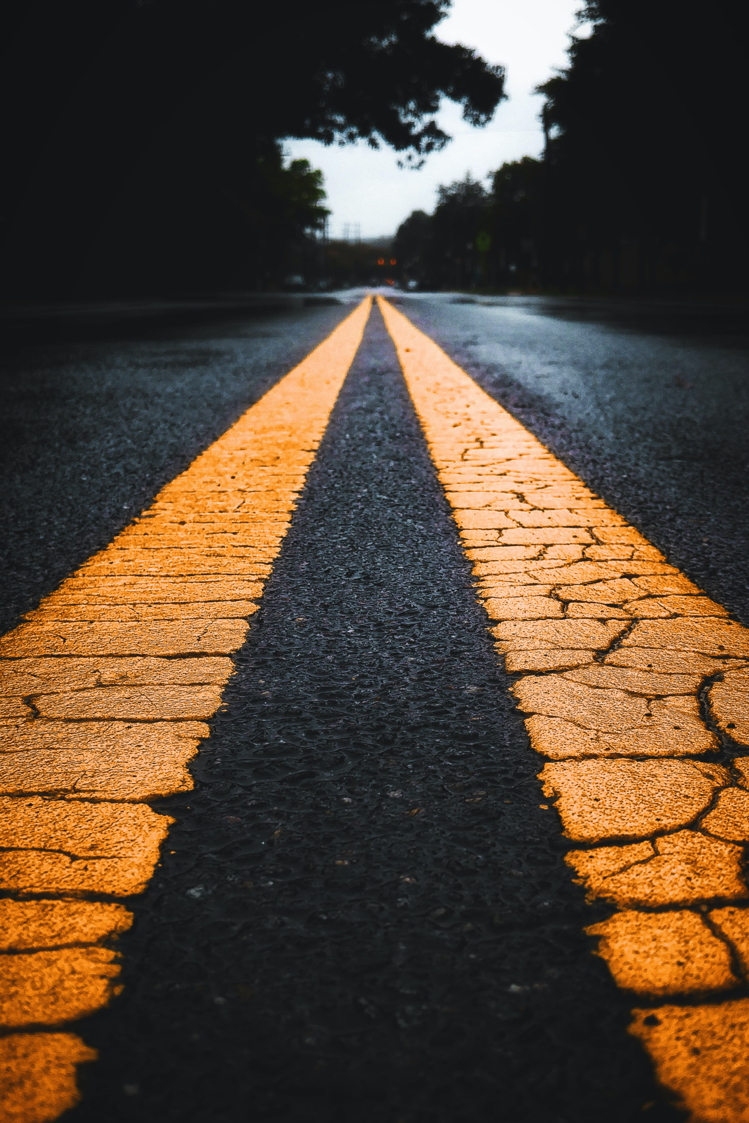 long exposure photo of yellow lines on road