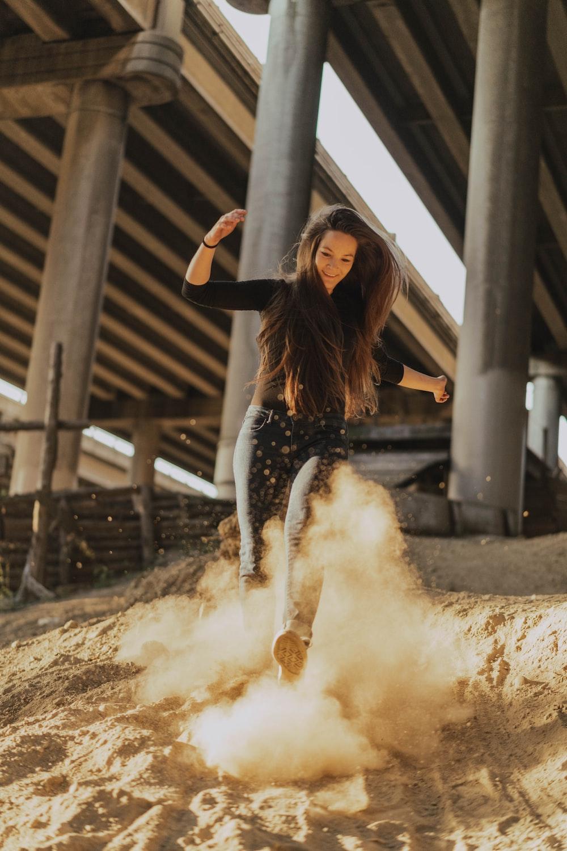 woman playing on sand
