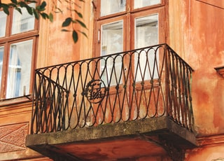 brown wooden windowpane near tree