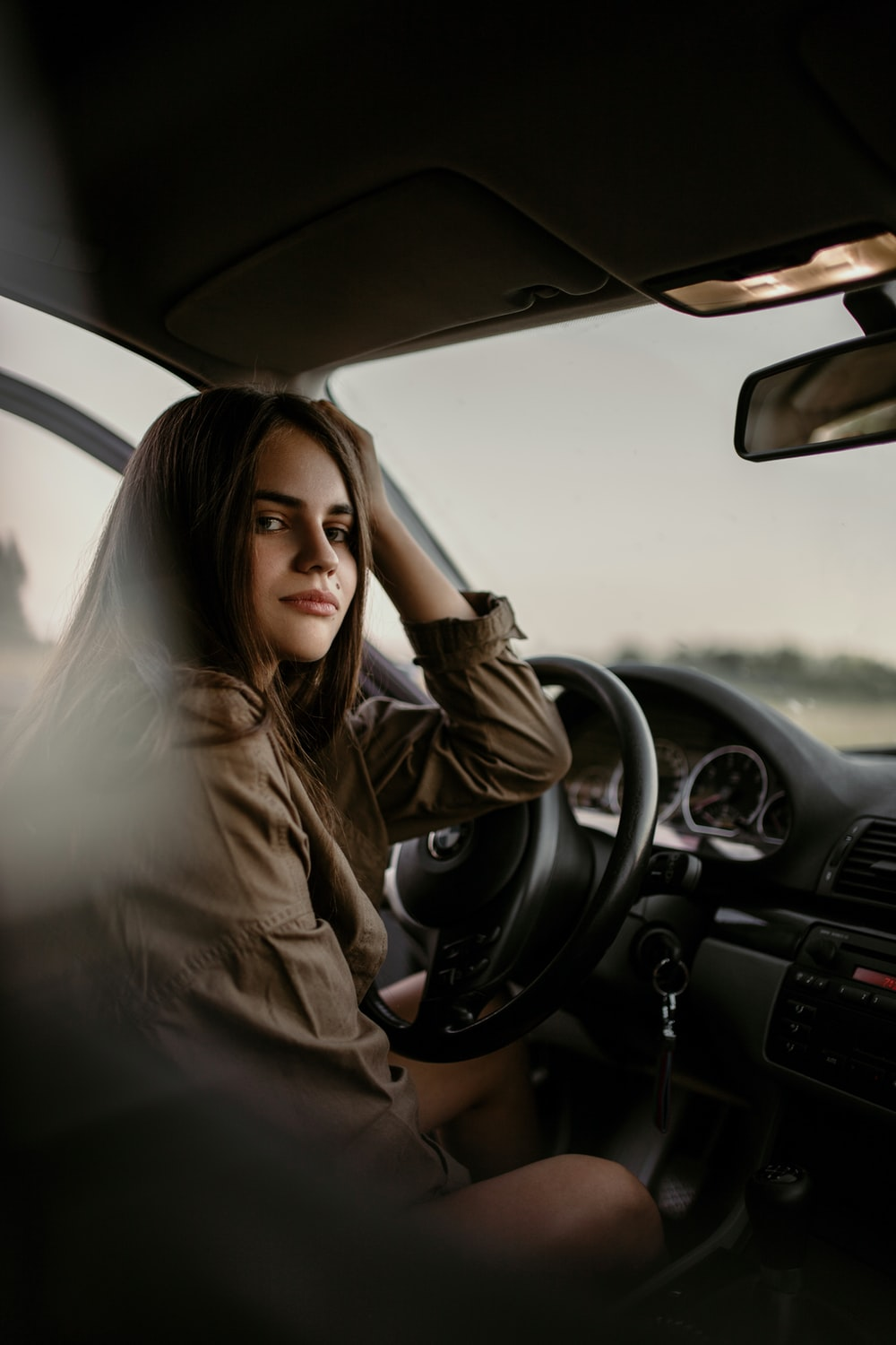 woman sitting inside car
