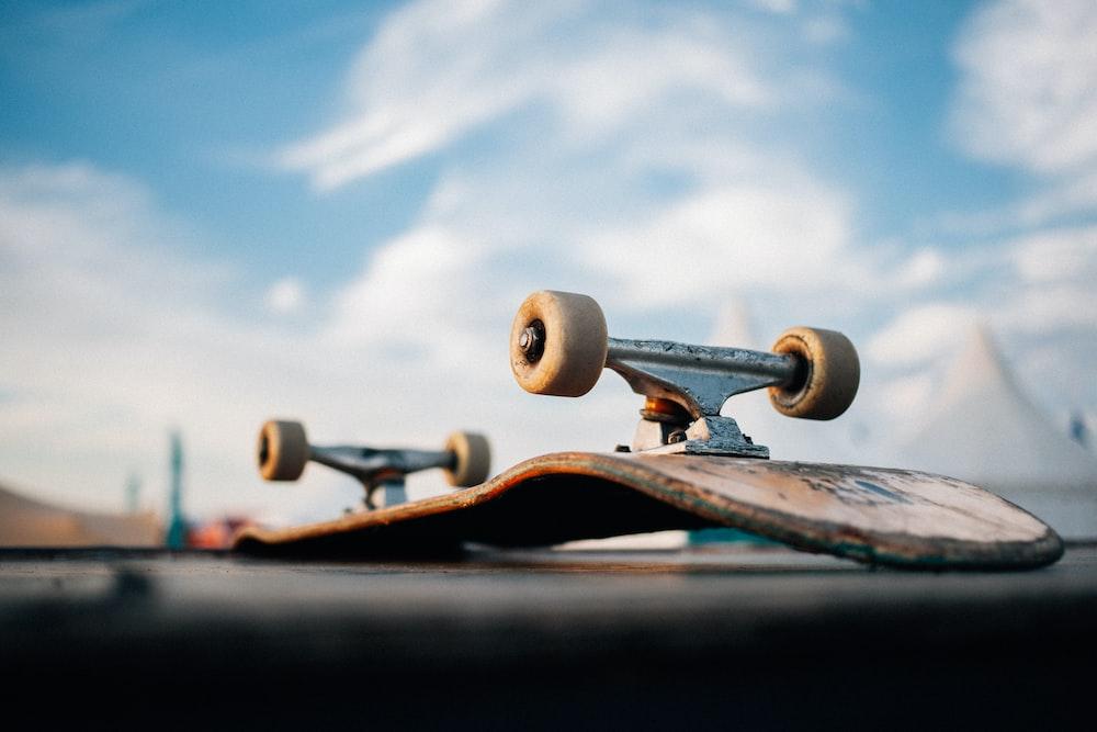 brown wooden skateboard