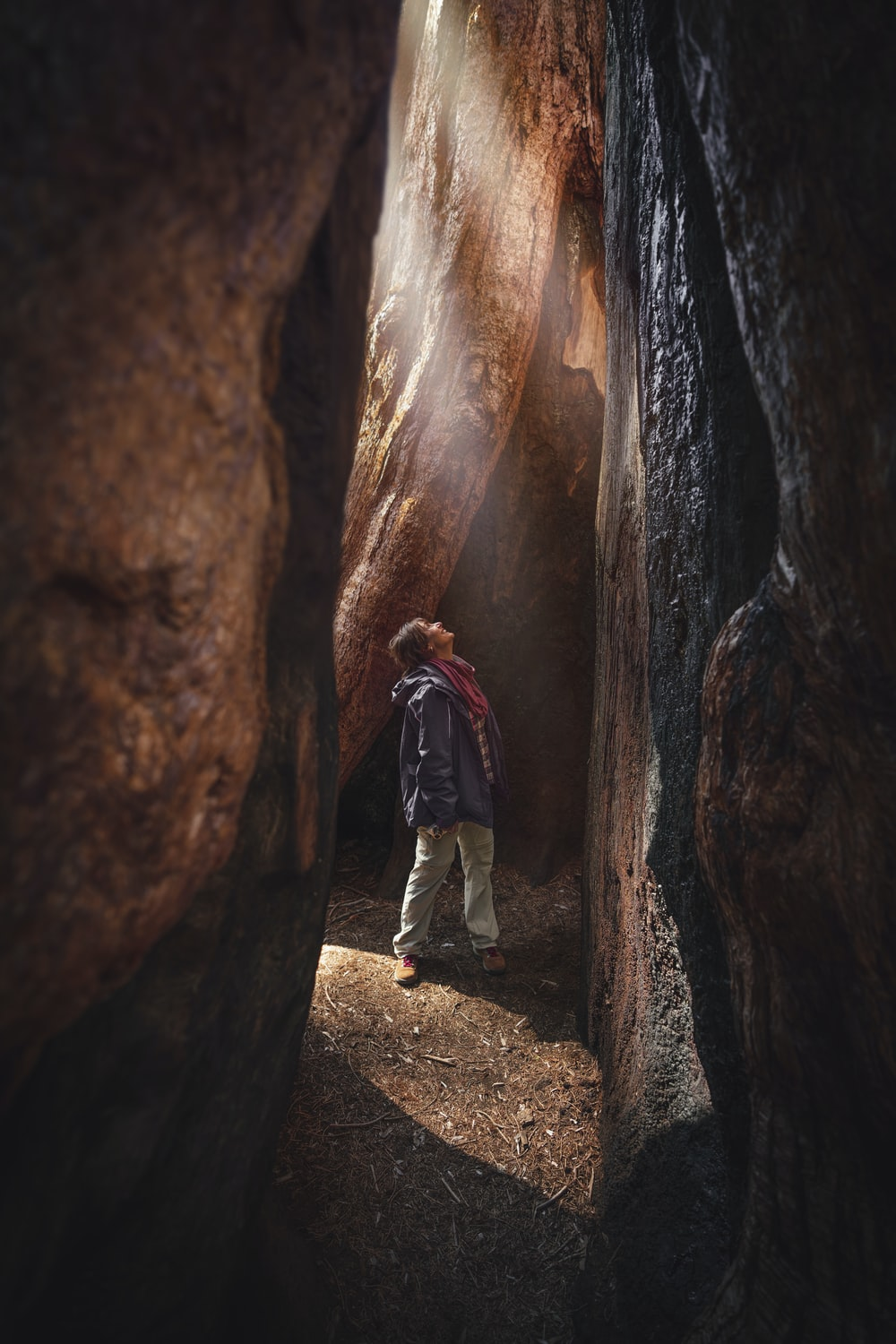 standing man inside cave