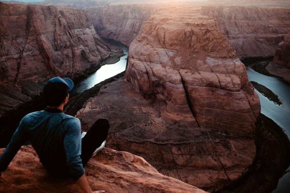 man sitting on Grand Canyon