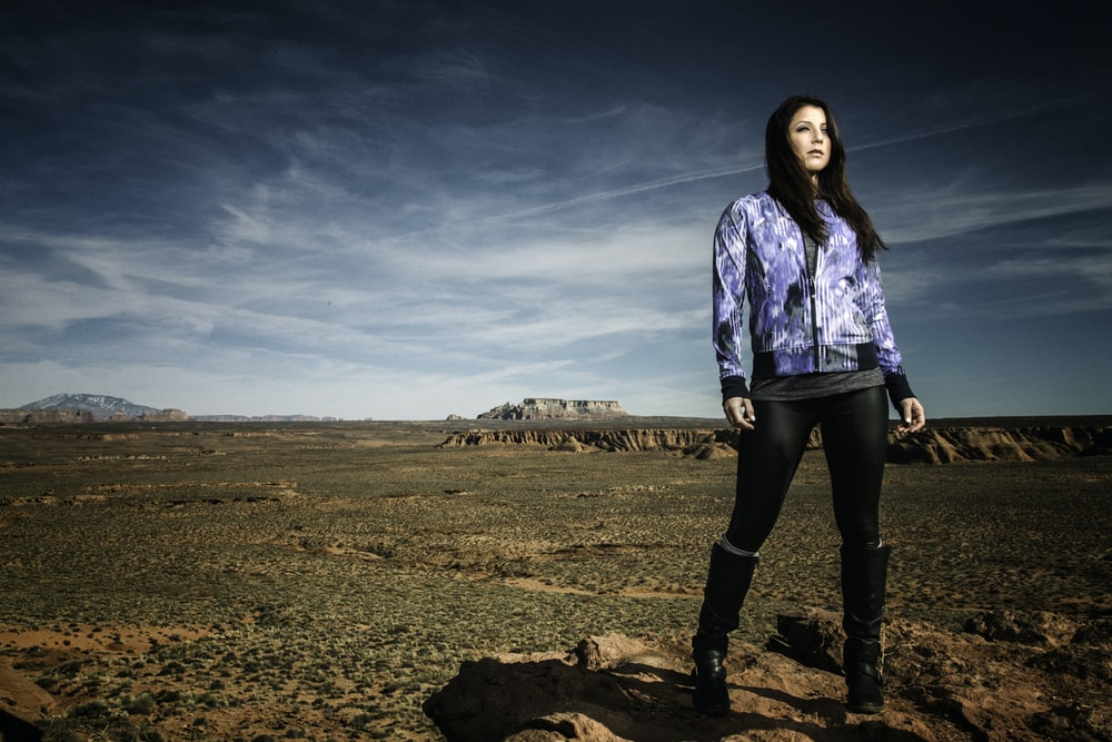 woman standing on brown soil