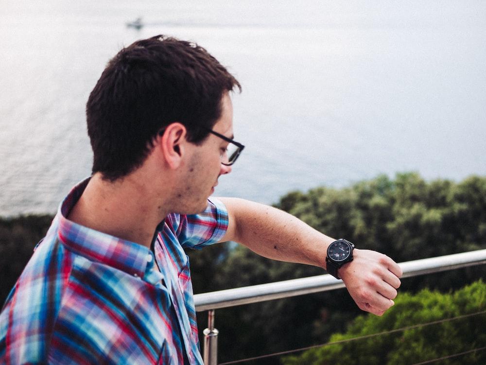 man watching his watch