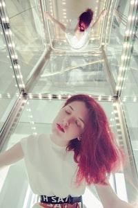 woman closing eyes inside elevator