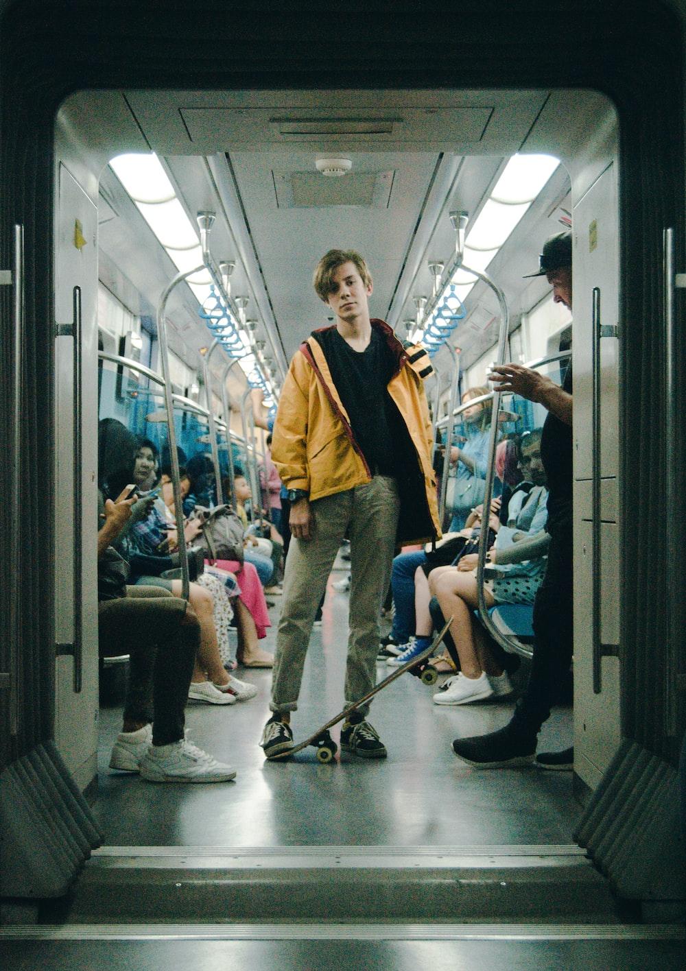 man wearing gray pants inside train