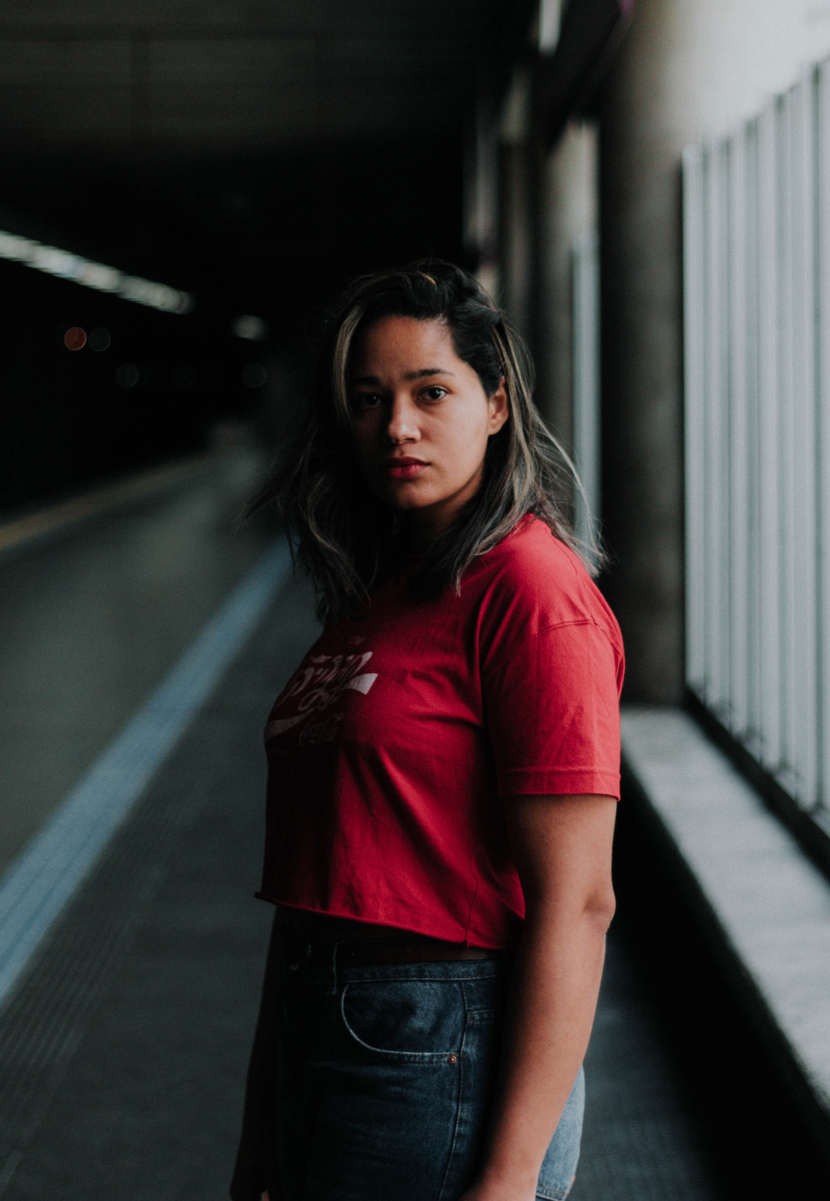depth of field photography of woman in red crop top