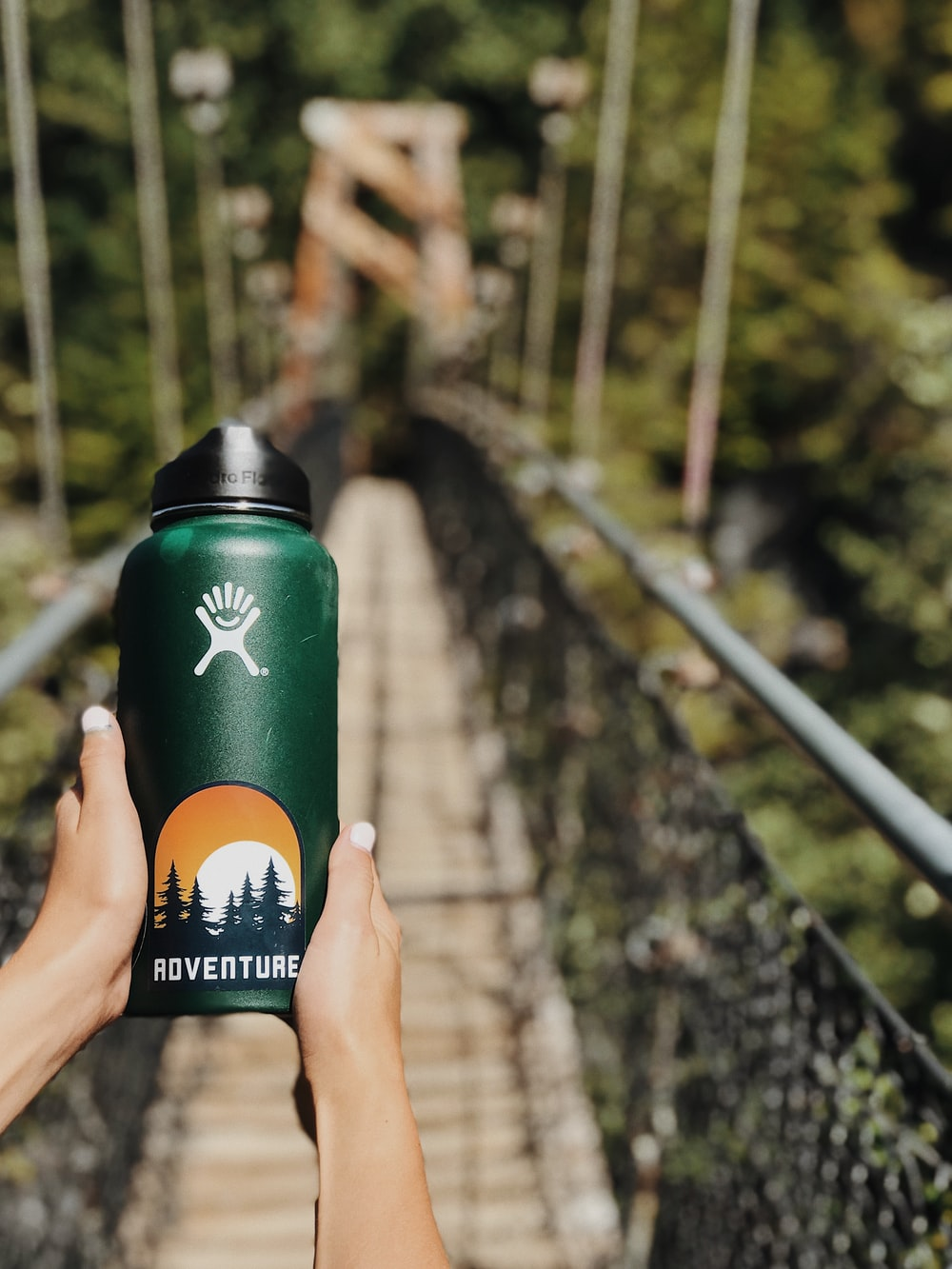 person holding green tumbler
