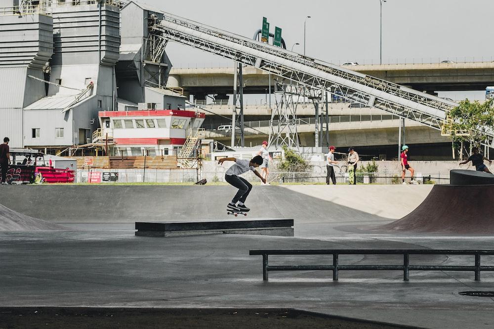 man skateboarding on gray concrete ramp